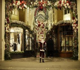 London taxi driver Michael Harris, dressed as Santa Claus, who said he was in hospital with coronavirus for three weeks earlier in the year, poses for photographs outside Burlington Arcade, during England's second coronavirus lockdown in London, Wednesday, Nov. 25, 2020. With major COVID-19 vaccines showing high levels of protection, British officials are cautiously — and they stress cautiously — optimistic that life may start returning to normal by early April. (AP Photo/Matt Dunham)