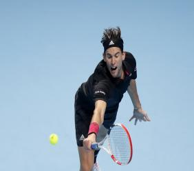 Dominic Thiem of Austria returns the ball to Novak Djokovic of Serbia during their semifinal match at the ATP World Finals tennis tournament at the O2 arena in London, Saturday, Nov. 21, 2020. (AP Photo/Frank Augstein).