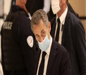 Former French President Nicolas Sarkozy arrives at the courtroom, Monday, Nov. 23, 2020 in Paris. Former French President Nicolas Sarkozy goes on trial Monday on charges of corruption and influence peddling in a phone-tapping scandal, a first for the 65-year-old politician who has faced several other judicial investigations since leaving office in 2012. (AP Photo/Michel Euler)
