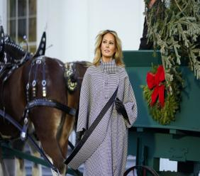 First lady Melania Trump stands next to the 2020 Official White House Christmas tree as it is presented on the North Portico of the White House, Monday, November 23, 2020, in Washington. (AP Photo/Andrew Harnik)