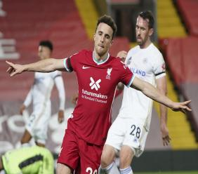 Liverpool's Diogo Jota, centre celebrates after scoring his sides second goal during the English Premier League football match against Leicester City at the Anfield stadium in Liverpool, England, Sunday, Nov. 22, 2020. (AP Photo/Jon Super).