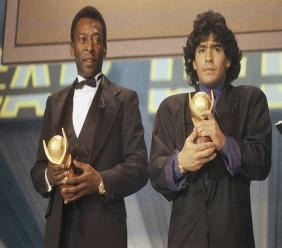 "In this March 1987 file photo, Pele, left, and Maradona hold ""Sports Oscar"" trophies in Milan, Rome. The Argentine football great who was among the best players ever and who led his country to the 1986 World Cup title before later struggling with cocaine use and obesity, died from a heart attack on Wednesday, November 25, 2020, at his home in Buenos Aires. He was 60. (AP Photo/File)"