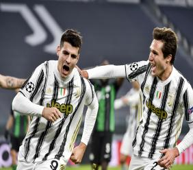 Juventus' Alvaro Morata celebrates a goal with teammate Federico Chiesa during the Champions league, group G soccer match between Juventus and Ferencvaros, at the Allianz Stadium in Turin, Italy, Tuesday, November 24, 2020. (Marco Alpozzi/LaPresse via AP)