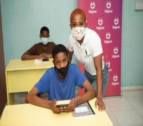 Shelly-Ann Fraser Pryce with a student at the Shelly-Ann Fraser-Pryce Resource Centre.