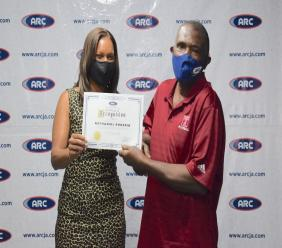 A delighted Nathaniel Prussia, a machine operator in the nail department, was recognized for his 22 years of service during ARC's Power Lunch Series recently.