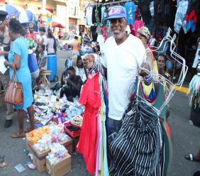 In this December 20, 2018 file photo, a vendor shows off some of his wares.