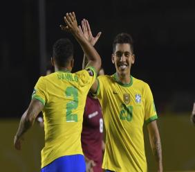 Brazil's Roberto Firmino, right, celebrates with teammate Danilo after scoring against Venezuela during a qualifying football match for the FIFA World Cup Qatar 2022 in Sao Paulo, Brazil, Friday, Nov.13, 2020. (Nelson Almeida/Pool via AP).