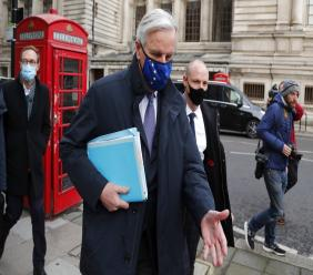 European Commission's Head of Task Force for Relations with the United Kingdom Michel Barnier walks from his hotel to the Conference Centre in London, Wednesday, November 11, 2020. With less than two months to go before the U.K. exits the EU's economic orbit, trade deal talks resume in London. (AP Photo/Frank Augstein)