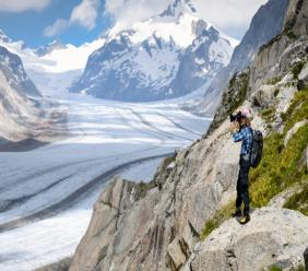 In this July 21, 2020 file photo, Swiss photographer David Carlier takes photographs of the Swiss Aletsch glacier, the longest glacier in Europe, on the sideline of his photographic exhibition, in Fieschertal, Switzerland. Photo: Laurent Gillieron/Keystone/ AP/ File