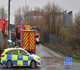 "Emergency services attend to a large explosion at a warehouse in Bristol, England, Thursday December 3, 2020. A local British emergency services department says there have been ""multiple casualties"" following a large explosion at a warehouse near the southwest England city of Bristol. (Ben Birchall/PA via AP)"