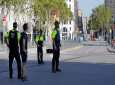 Police officers cordon off a street in Barcelona, Spain, Thursday, Aug. 17, 2017. Police in the northern Spanish city of Barcelona say a white van has jumped the sidewalk in the city's historic Las Ramblas district, injuring several people. (AP Photo/Manu Fernandez)