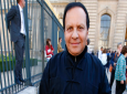 A Friday, Sept. 26, 2014 file photo of Tunisian-born fashion designer Azzedine Alaia arriving at Christian Dior's Spring/Summer 2015 ready-to-wear fashion collection presented in Paris, France. (AP Photo/Francois Mori, File)