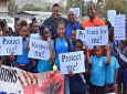 Education Minister Anthony Garcia, Minister of State in the Ministry of Education Dr Lovell Francis and Sport Minister Darryl Smith pose with Students at the Walk Against Crime - Walk for Sport, on Wednesday 5th April, 2017.