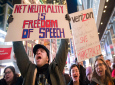 """Demonstrators rally in support of net neutrality outside a Verizon store in New York. The FCC is voting to undo Obama-era """"net neutrality"""" rules that guaranteed equal access to the internet. The industry promises that the internet experience isn't going to change, but the issue has struck a nerve. Protests have erupted online and in the streets as everyday Americans worry that companies like Comcast, Verizon and AT&T will be able to control what they see and do online."""