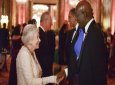 Queen Elizabeth II greets T&T Prime Minister Keith Rowley (right) while her son, Prince Charles (second left) engages Jamaica's Prime Minister Andrew Holness in discussion. (PHOTO: AP)