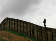 This April 27, 2006 file photo shows the U.S.-Mexico border fence near Smuggler's Gulch west of the San Ysidro Port of Entry in San Diego. Twenty-six days after being apprehended on May 23, 2018 at the U.S.-Mexico border with his son, a Brazilian man in detention says he has no idea when he may see his 9-year-old, who he fears is distraught and having difficulty communicating since he only speaks Portuguese. (AP Photo/Denis Poroy, File)