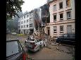 A car and a house are destroyed after an explosion in Wuppertal, Germany, June 24, 2018. German police say 25 people were injured, when an explosion destroyed a several-store building in the western city of Wuppertal.