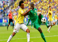 Colombia's Juan Cuadrado, left, vies for the ball with Senegal's Kalidou Koulibaly, right, during the group H match between Senegal and Colombia, at the 2018 soccer World Cup in the Samara Arena in Samara, Russia, Thursday, June 28, 2018. (AP Photo/Martin Meissner)