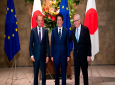 Japanese Prime Minister Shinzo Abe, center, smiles with European Commission President Jean-Claude Juncker, right, and European Council President Donald Tusk before a meeting at Abe's official residence in Tokyo Tuesday, July 17, 2018. The European Union and Japan are signing a widespread trade deal Tuesday that will eliminate nearly all tariffs, seemingly defying the worries about trade tensions set off by U.S. President Donald Trump's policies. (Martin Bureau/Pool Photo via AP)