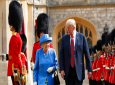 President Donald Trump with Queen Elizabeth II, inspecting the Guard of Honour at Windsor Castle in Windsor, England, Friday, July 13, 2018. (AP Photo/Pablo Martinez Monsivais)