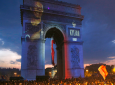 The name of French soccer player Kylian Mbappe is projected onto the Arc de Triomphe as soccer fans invade the Champs Elysees avenue after France won the soccer World Cup final match between France and Croatia, Sunday, July 15, 2018 in Paris. France won its second World Cup title by beating Croatia 4-2(AP Photo/Thibault Camus)