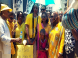 Photo: Opposition Leader Kamla Persad-Bissessar stands outside the office of the Prime Minister with former HDC Manager Jearlean John and supporters, calling for an apology over a recent display which showed a woman being made to remove her yellow robe to reveal a red-PNM t-shirt.