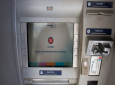 An automated cash machine displays a temporary out of service message, in Caracas, Venezuela, Monday, Aug. 20, 2018. Venezuelans are bracing for dramatic economic measures the government has announced, including a more-than-3,000 percent hike in the minimum wage. The changes start to take effect Monday with introduction of a new currency that lops five zeros off the country's fast-depreciating bills. (AP Photo/Ariana Cubillos)