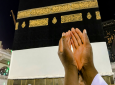 A Muslim pilgrim, only hands seen, prays near the Kaaba, the cubic building at the Grand Mosque, ahead of the annual Hajj pilgrimage, in the Muslim holy city of Mecca, Saudi Arabia, Friday, Aug. 17, 2018. The annual Islamic pilgrimage draws millions of visitors each year, making it the largest yearly gathering of people in the world. (AP Photo/Dar Yasin)
