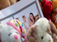 A photograph sits amid the tributes as they grow outside the home where a pregnant woman, Shanann Watts, and her two daughters, Bella and Celeste, lived Thursday, Aug. 16, 2018, in Frederick, Colo. (AP Photo/David Zalubowski)