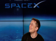 In this Feb. 6, 2018 file photo, Elon Musk, founder, CEO, and lead designer of SpaceX, speaks at a news conference after the Falcon 9 SpaceX heavy rocket launched successfully from the Kennedy Space Center in Cape Canaveral, Fla. SpaceX says it's signed the first private moon traveler. The big reveal on who it is _ and when the flight to the moon will be _ is scheduled for Monday, Sept. 17, 2018. (AP Photo/John Raoux)