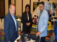 Minister Gopee-Scoon (centre) along with Mr. John McIntyre, Charge D'Affaires, US Embassy (left), looks at the security products on display by Puerto Rican company participating in the Trade Mission