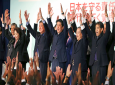 "Japan's Prime Minister Shinzo Abe, center, shouts traditional ""Banzai (long life)"" cheers with other Liberal Democratic Party lawmakers shortly after winning of the ruling party presidential elections at its headquarters in Tokyo, Thursday, Sept. 20, 2018. Abe has been re-elected as head of his ruling Liberal Democratic Party in a landslide, paving the way for up to three more years as the nation's leader. (AP Photo/Koji Sasahara)"