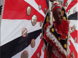 A junior masquerader displays the T&T colours during a parade to launch Carnival 2019.