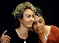 Stacey Pinkerton, left and Chelan Lasha embrace during a news conference, Tuesday, Sept. 25, 2018, in Norristown Pa., after Bill Cosby was sentenced to three-to 10-years for sexual assault. (AP Photo/Matt Rourke)