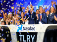In this July 19, 2018, file photo Brendan Kennedy, third from right in front, CEO and founder of British Columbia-based Tilray Inc., a major Canadian marijuana grower, leads cheers as confetti falls to celebrate his company's IPO (TLRY) at Nasdaq in New York. Investors are craving marijuana stocks as Canada prepares to legalize pot next month, leading to giant gains for Canada-based companies listed on U.S. exchanges. (AP Photo/Bebeto Matthews, File).