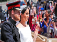 In this file photo dated Saturday, May 19, 2018, Britain's Prince Harry and his bride Meghan Markle, ride in a carriage after their wedding ceremony. (AP Photo/Frank Augstein, FILE)