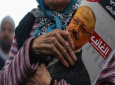 A woman holds a poster during the funeral prayers in absentia for Saudi writer Jamal Khashoggi who was killed last month in the Saudi Arabia consulate, in Istanbul, Friday, Nov. 16, 2018. Turkey's Foreign Minister Mevlut Cavusoglu on Thursday called for an international investigation into the killing of the Saudi dissident Jamal Khashoggi. (AP Photo/Emrah Gurel)