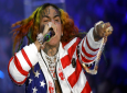 In this Sept. 21, 2018, file photo rapper Daniel Hernandez, known as Tekashi 6ix9ine, performs during the Philipp Plein women's 2019 Spring-Summer collection, unveiled during the Fashion Week in Milan, Italy. (AP Photo/Luca Bruno, File)