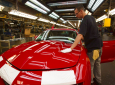 FILE - In this June 10, 2011, file photo, a worker checks the paint on a Camaro at the GM factory in Oshawa, Ontario. General Motors is closing a Canadian plant at the cost of about 2,500 jobs, but that is apparently just a piece of a much broader, company-wide restructuring that will be announced as early as Monday, Nov. 26, 2018. (Frank Gunn/The Canadian Press via AP, File)