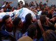 Mourners chant Islamic slogans while carrying the body of Hamas militant commander Nour el-Deen Barakas, who was killed during an Israeli raid late Sunday, during his funeral, at his family house in Khan Younis, southern Gaza Strip, Monday, Nov. 12, 2018. (AP Photo/Adel Hana)