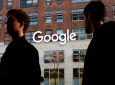 FILE - In this Dec. 4, 2017 file photo, people walk by Google offices in New York. Google is still having trouble protecting the personal information on its Plus service, prodding the company to accelerate its plans to shut down a little-used social network created to compete against Facebook. (AP Photo/Mark Lennihan, File)
