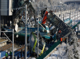 Members of rescue services work at the scene of a train accident in Ankara, Turkey, Thursday, Dec. 13, 2018. A high-speed train hit a railway engine and crashed into a pedestrian overpass at a station in the Turkish capital Ankara on Thursday, killing more than 5 people and injuring more than 40 others, officials and news reports said. (AP Photo/Burhan Ozbilici)