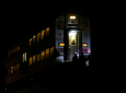 Passengers sit on a train while police officers work the scene where two officers were killed after they were struck by a South Shore train near 103rd Street and Dauphin Avenue on Monday, Dec. 17, 2018, in Chicago. (E. Jason Wambsgans/Chicago Tribune via AP)