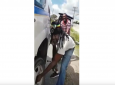 Taxi drivers 'Quick Silver' and 'Tony' change a flat tyre on a police service vehicle.