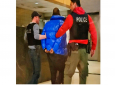 In this still image taken from video, R. Kelly is escorted by police in custody at the Chicago Police Department's Central District Friday night, Feb. 22, 2019, in Chicago.