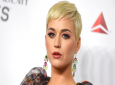 FILE - In this Feb. 8, 2019 file photo Katy Perry arrives at MusiCares Person of the Year honoring Dolly Parton in Los Angeles. Perry's fashion line has pulled two types of shoes after some people compared them to blackface. The Ora Face Block Heel and Rue Face Slip-On Loafers were released last summer in nine different colors. They included protruding eyes, nose and red lips. (Photo by Jordan Strauss/Invision/AP, File)