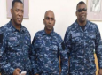 Members of the Police Service Social and Welfare Association sport camouflage uniforms. From left, Inspector Michael Seales, Inspector Anand Ramesar and Inspector Roger Alexander.
