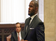 FILE - In this Friday, March 22, 2019 file photo, R. Kelly appears for a hearing at the Leighton Criminal Court Building in Chicago, Illinois. Dubai's government on Sunday forcefully denied a claim by R&B singer R. Kelly that the artist had planned concerts in the sheikhdom after he had sought permission from an Illinois judge to travel here despite facing sexual-abuse charges. (E. Jason Wambsgans/Chicago Tribune via AP, Pool, File)