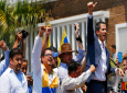 In this Saturday, March 16, 2019 photo, lawyer Roberto Marrero, left, attends a rally with Venezuelan opposition leader Juan Guaido, right, who has declared himself interim president in Valencia, Venezuela. (AP Photo/Fernando Llano)