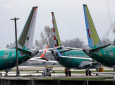 FILE- In this Nov. 14, 2018, file photo Boeing 737 MAX 8 planes are parked near Boeing Co.'s 737 assembly facility in Renton, Wash. Investigators were rushing to the scene of a devastating plane crash in Ethiopia on Sunday, March 10, 2019, an accident that could renew safety questions about the newest version of Boeing's popular 737 airliner. (AP Photo/Ted S. Warren, File)